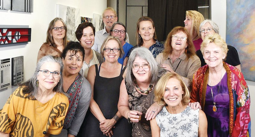 Members of the new D'art Gallery in the Santa Fe Art District pose for a photo after hanging their pieces for a show. The gallery has 17 artist members and opened in August.