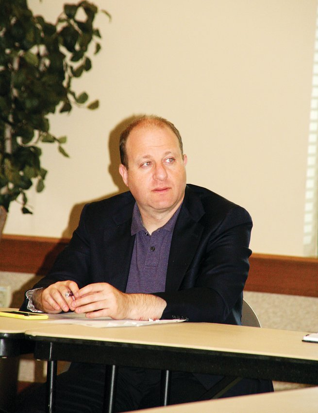 Colorado Gov. Jared Polis listens to some of the challenges women business leaders face during a roundtable discussion on Sept. 4 in Wheat Ridge.