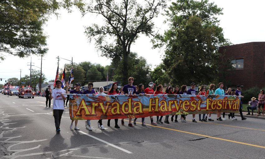 Students from Arvada High School and Arvada West High School lead the Arvada Harvest Parade down Ralston Road.
