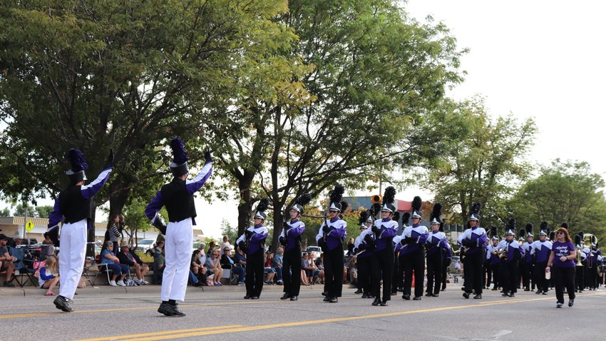 The Arvada West marching band participates in the parade at the Arvada Harvest Festival.
