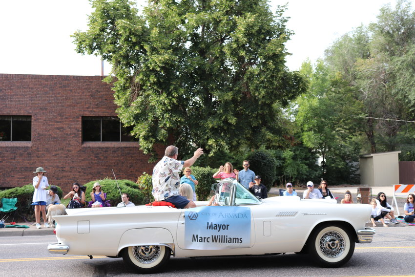 Mayor Marc Williams waves to locals lined up for the parade.