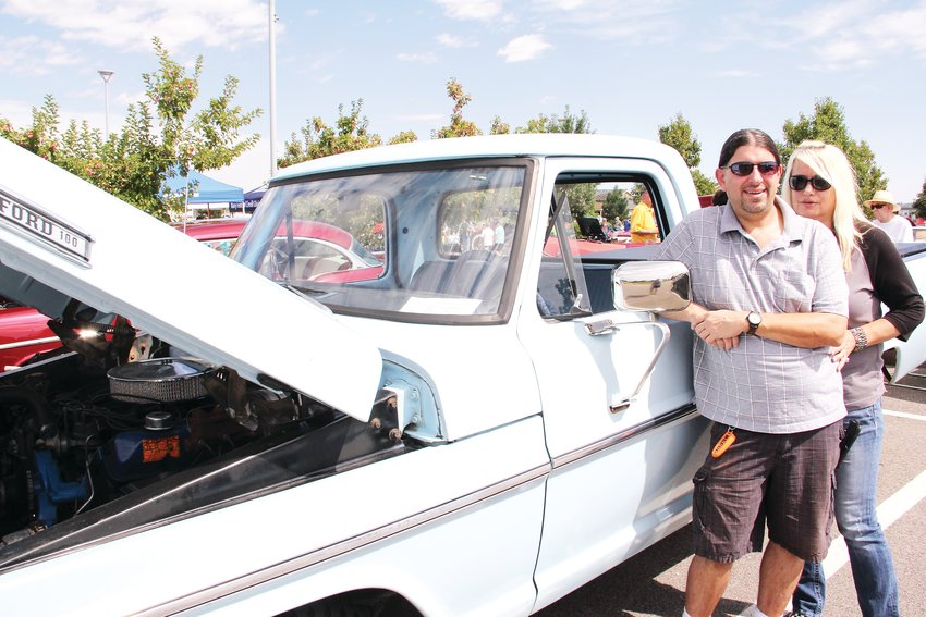 Steven Shermer, 41, stands with his girlfriend, Rhonda Katreeb, next to Shermer's 1972 Ford F-100 at Centennial Center Park. The city's fourth annual Car Show Sept. 7 featured area residents' classic and collectible cars.