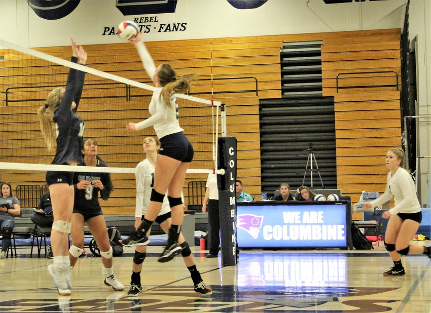 At the net Sept. 5 against Columbine, Legacy junior Sarah Leonard leaps to make contact at Columbine High School.