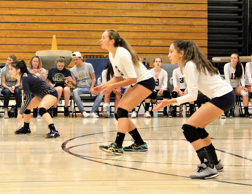 Legacy (left to right) senior Grace Valdez and freshmen Kayla Dayhuff, Alexandra Urbina await the serve from Columbine Sept. 5.