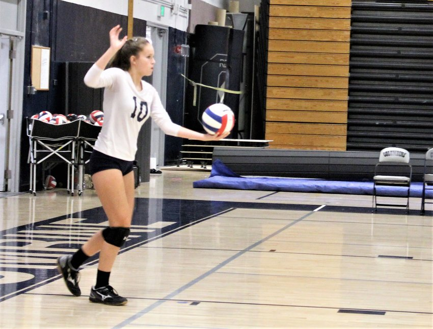 Against Columbine Sept. 5, Legacy freshman Alynna Haggadone anticipates making the serve at Columbine High School.