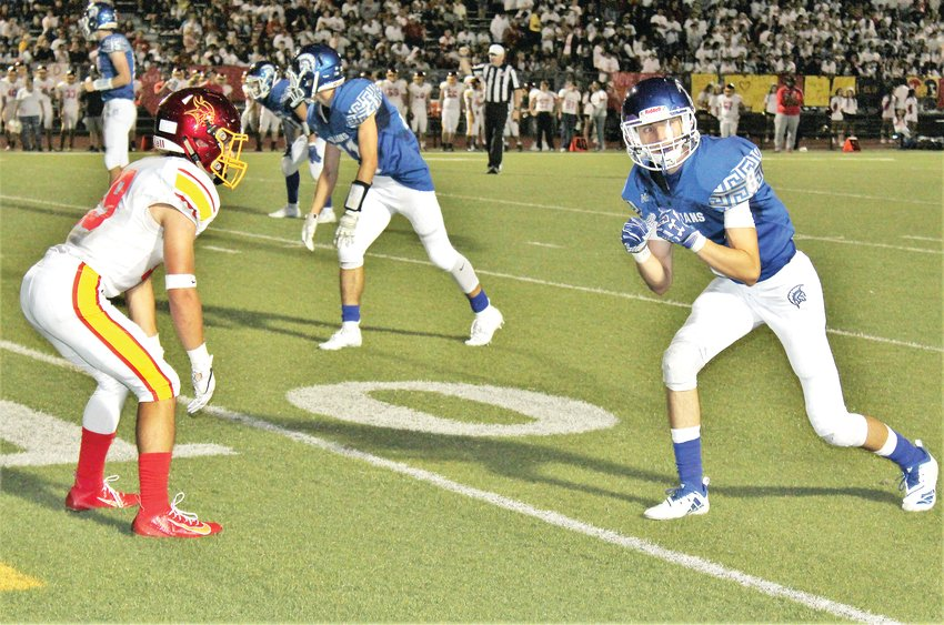 Aug. 30, Northglenn senior Lamar Opila and Thornton junior Anthony Lobato line up before the play at Five Star Stadium.