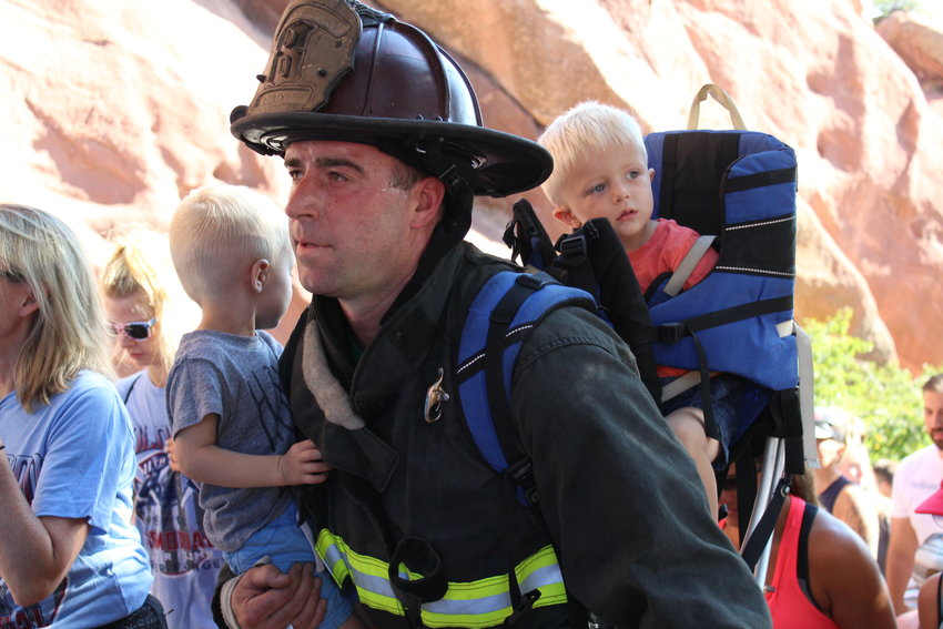 Dan Toomey of the Aurora Fire Department climbs with his twin sons Brody and Braxton. The event was held to pay tribute to the 343 FDNY firefighters and the nearly 3,000 Americans who died on 9/11.