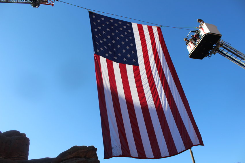 The American flag hangs high over 2,500 firefighters and residents at the Colorado Memorial Stair Climb.