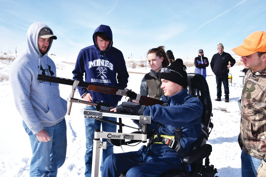 Colorado School of Mines engineering students work on an adaptive equipment design for recreational outings during a River Deep Foundation outing at Valhalla Hunt Club in Bennett.