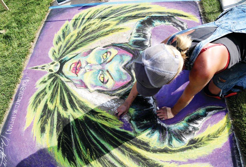 Artist Destiny Humrich creates a chalk piece at Ridgefest Sept. 7.