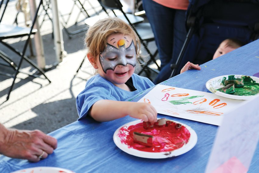 Joseph Hutchinson, 3, makes art at the kids craft tent Sept. 7.