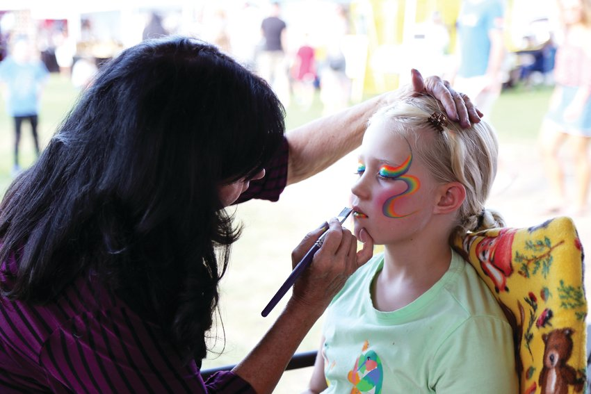 Jaryn Pegues, 8, gets her face painted Sept. 7 at the annual Ridgefest.