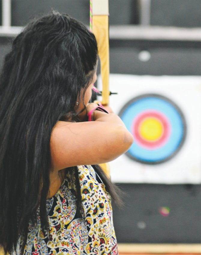 Archer Tina Prigge of Arvada takes aim at her target Sept. 5 at Broomfield's Empty Quiver Archery.