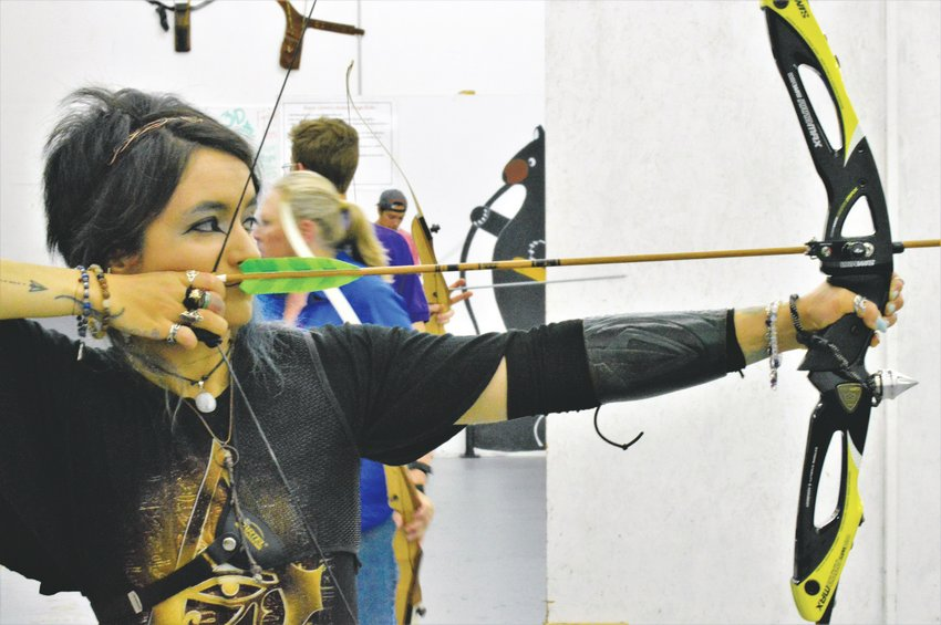 Evangeline Christel of Boulder, the 10th ranked barebow recurve archer in the nation, takes aim at a target in Broomfield's Empty Quiver Archery. She and her husband try and make it to the range daily for practice.