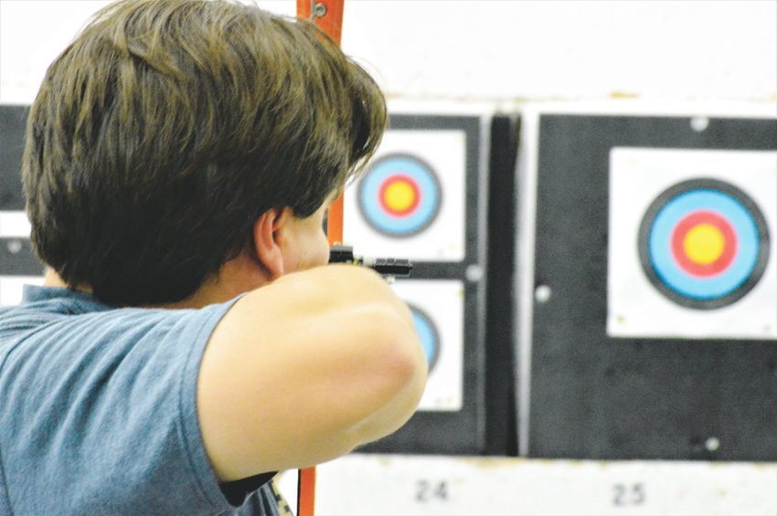 Leonardo Carrasco of Boulder takes aim at a target Sept. 5 in Broomfield's Empty Quiver Archery. Carrasco is currently ranked 14th nationally among barebow recurve archers. // Scott Taylor