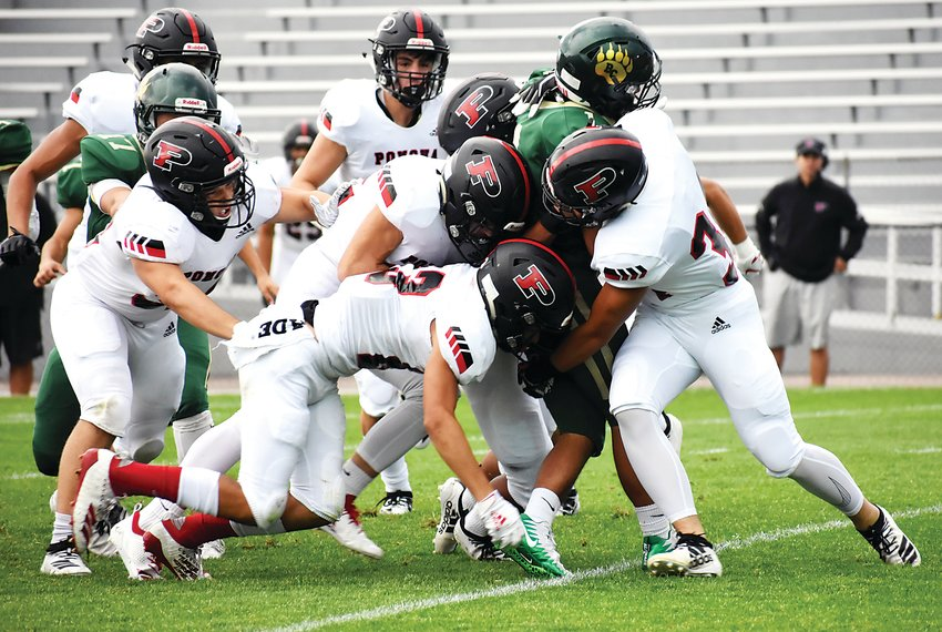 A host of Panthers take down Bear Creek junior Adrian Valenzuela during a first-quarter kickoff Friday, Sept. 6, at Jeffco Stadium. Pomona bounced back with a victory after a tough Week 1 loss to Regis Jesuit.