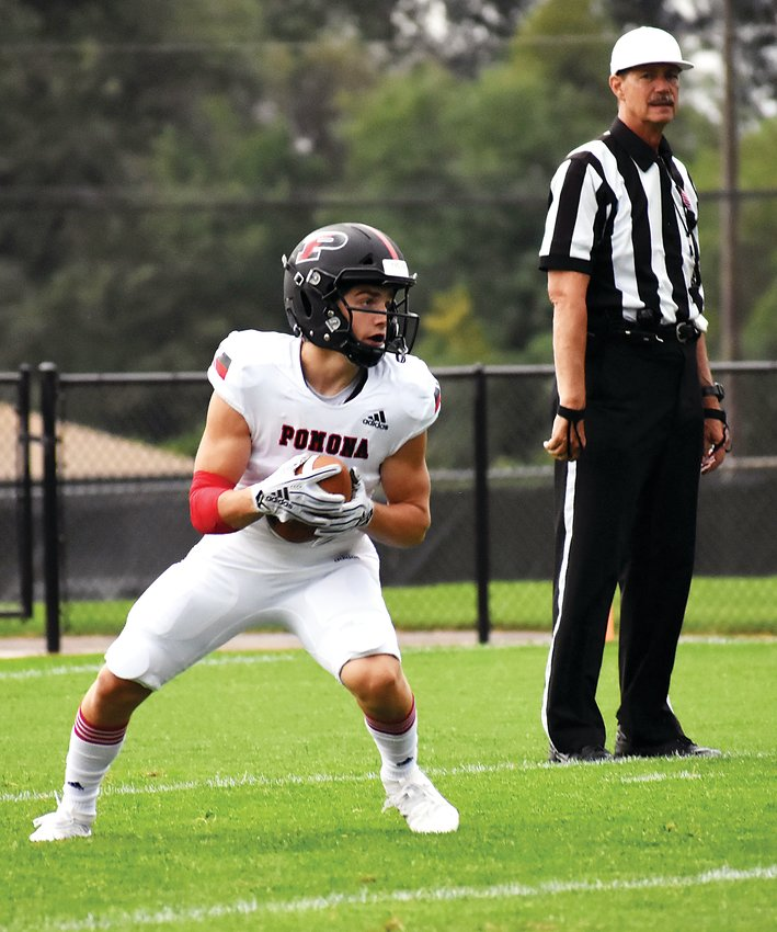 Pomona junior Jack Pospisil fields the opening kickoff Friday, Sept. 6, at Jeffco Stadium. Pospisil returned it 98 yards in 15 seconds for a Panther touchdown. Pospisil also had a pair of touchdown receptions in Pomona's 49-6 victory over old Jeffco rival Bear Creek.