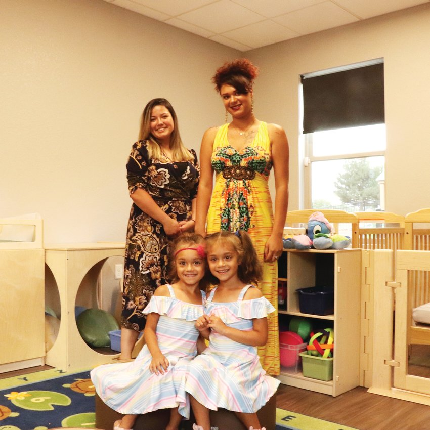 Hope House moms Janelle Markel, left, Alixandria Jones and Jones' daughters, Auburn and Izabella, pose together in one of the new resource center's early childhood learning rooms, which will allow the nonprofit to expand the number of childcare spaces it previously offered.