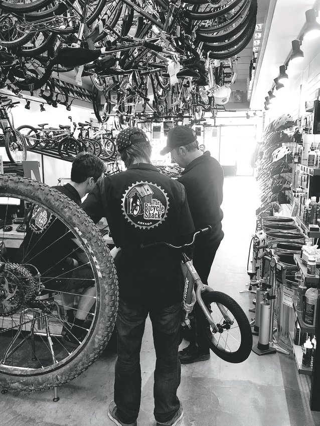 Employees work at The Bicycle Shack, a cycling shop located at 16255 W. 64th Ave.