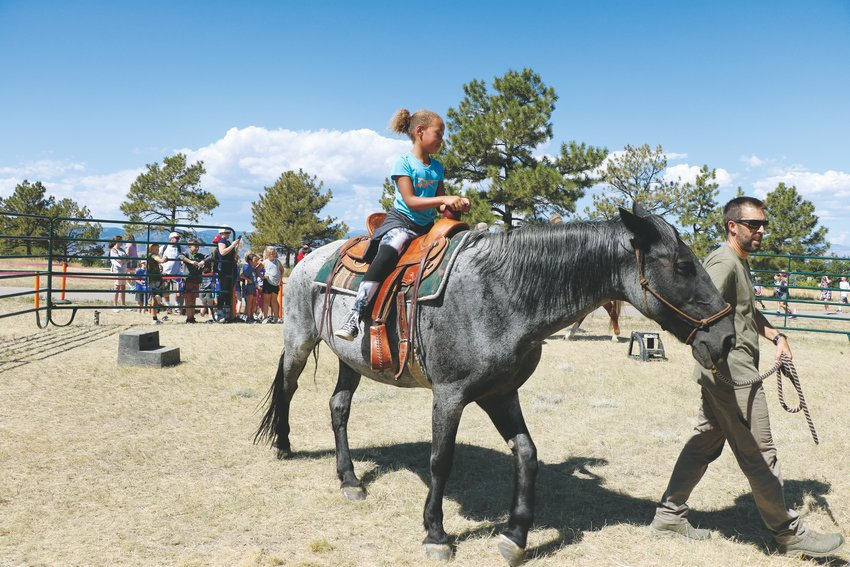 Emily Campbell, a fourth-grader at Pine Lane Elementary, rides a horse during Highlands Ranch Pioneer Days. The annual event exists to celebrate the state's heritage.