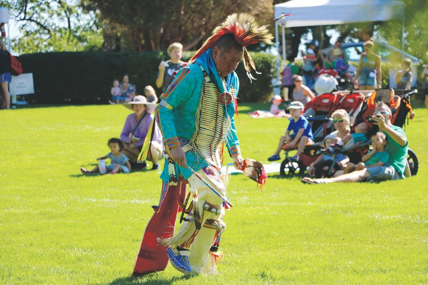 Leonard Cozad performs a traditional Native American dance for students at Highlands Ranch Pioneer Days. Members of Cozad's family, who are all part of the Kiowa tribe, also performed.