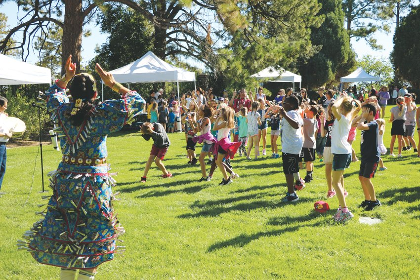 "Raelene Whiteshield leads students in a traditional ""rabbit dance"" during Highlands Ranch Pioneer Days."