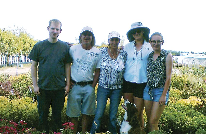 Holly Acres Nursery staff, from left: Joe Markert, Steve Fritz, Kelley Bonds, Lori Fidrich, Sarah Bonds, and Saturn, the springer spaniel greenhouse greeter. This knowledgeable staff can answer any gardening question about their plants grown on site.