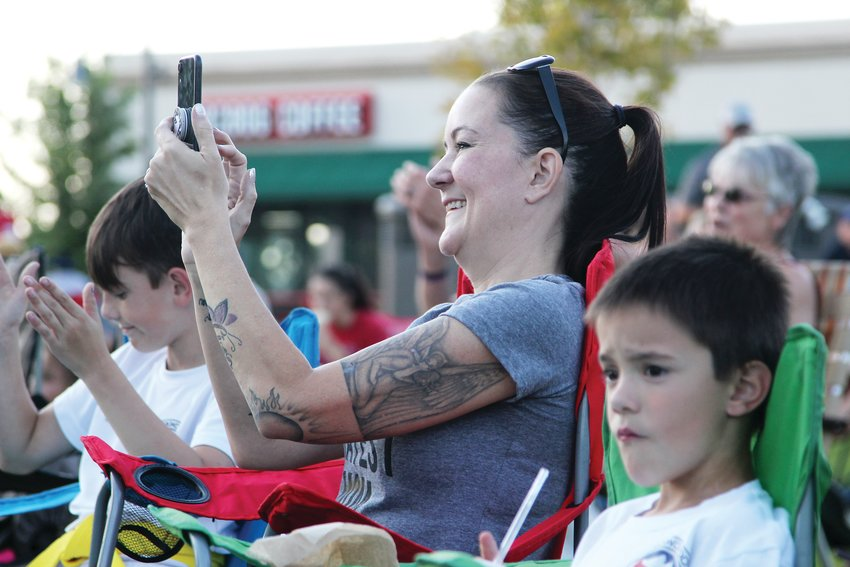 Amy Walker of Castle Rock takes a photo while watching a lip sync performance with her sons, Miles and Max Kopke.