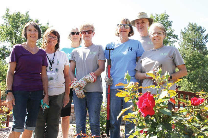 From left, volunteer gardeners Peggy Williams, Cindy Lund, Holly Penn, Cathy Pick, Terri Thomson, Dave Ingram and Karen Thurman stand at the rose garden Sept. 11 at Hudson Gardens in Littleton.