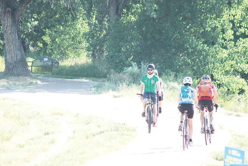 Riders cruise the Mary Carter Greenway through Littleton on Bike to Work Day, June 27, 2018.