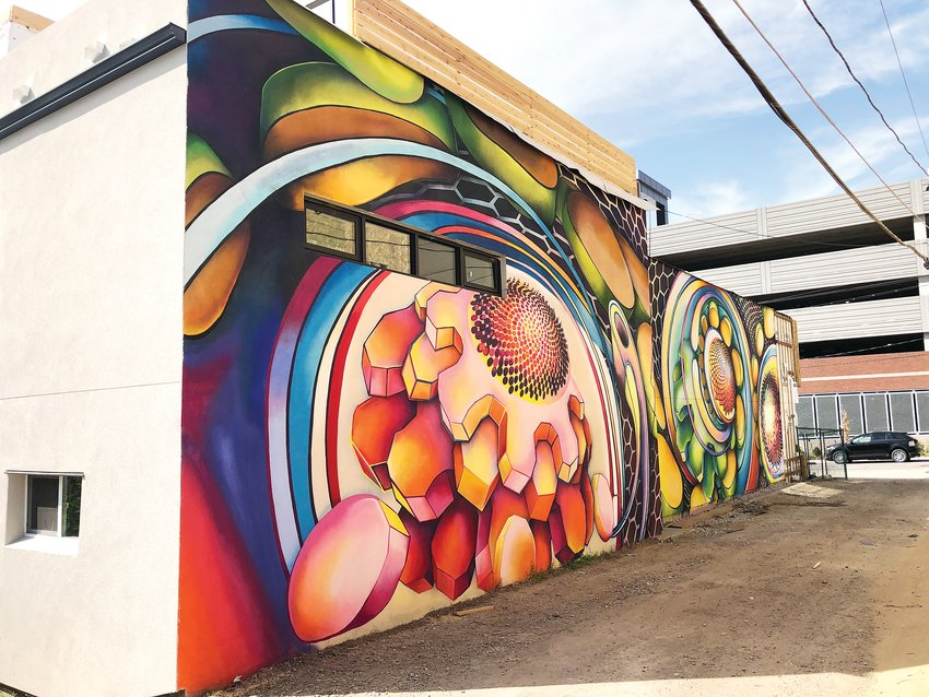 A mural on the side of Grow + Gather. Inside the building will be a hydroponic system where plants will grow on indoor towers.