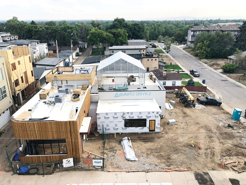 A view of the construction site at Grow + Gather, located at 900 E. Hampden Ave. The building used to be home to Bill's Auto Service.