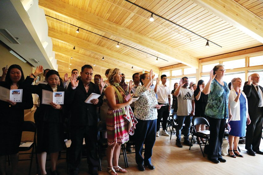 New citizens take an oath swearing allegiance to the United States during the naturalization ceremony.