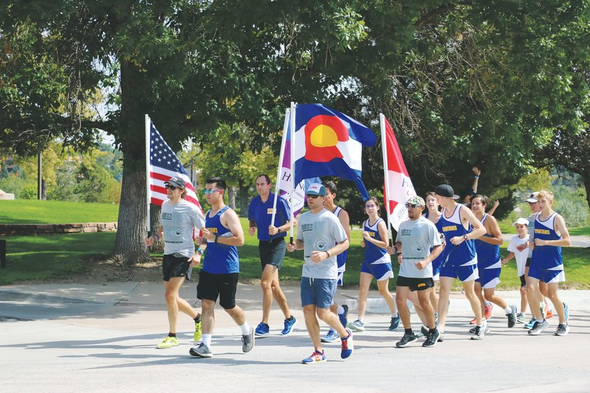 Runners in blue, from STEM's cross-country team, joined volunteers from Run For the Fallen during the tribute for Kendrick Castillo, who was killed in the May 7 STEM shooting. They ran the mile dedicated to Kendrick with the volunteers.