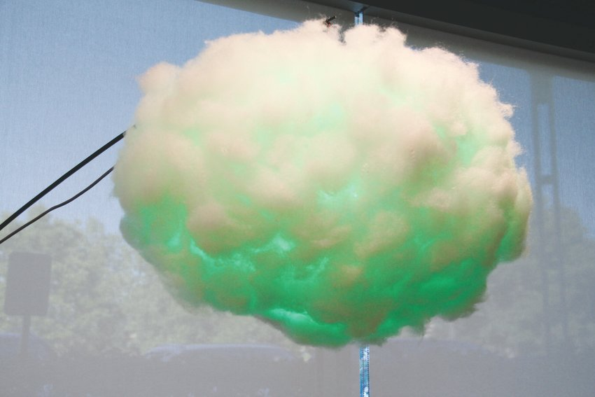 "A ""cloud"" that can read people's mood and turn certain colors that correspond to it — green is for surprised — sits in a part of the Colorado Open Lab Sept. 12."