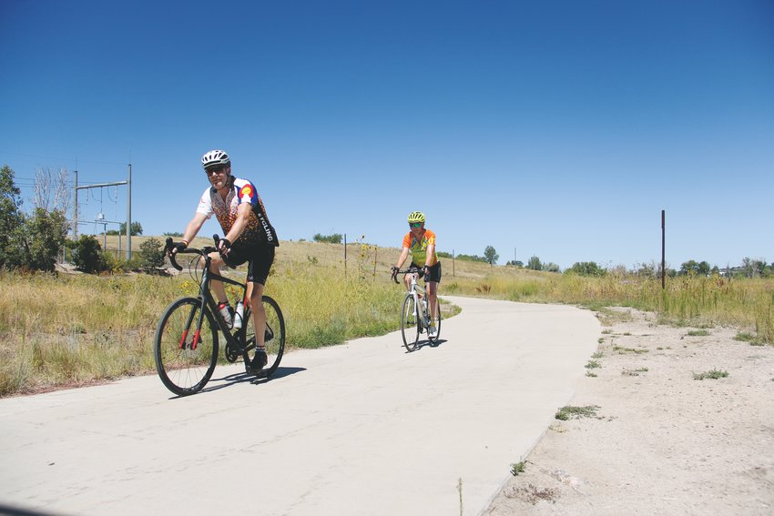 Cyclists ride recently on the Cherry Creek Trail near Centennial.