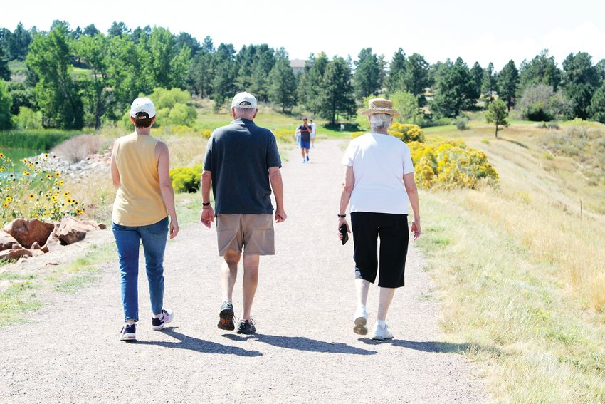 Part of trail etiquette means staying to the right and allowing oncoming trail users space to pass, not taking up the width of the trail like these pedestrians at Bingham Lake Park in The Pinery, near Parker.