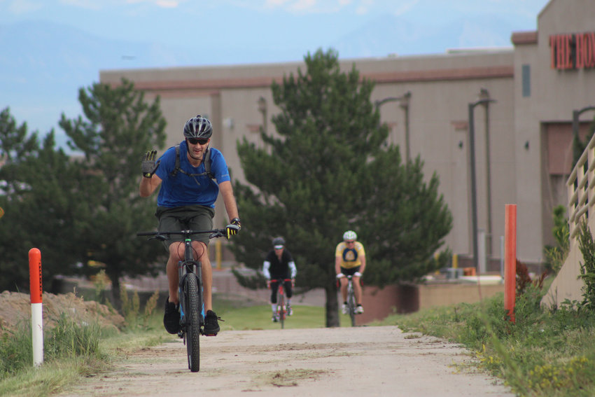 People bike to work from the Willow Creek Trail near C-470 and Yosemite in Lone Tree, a popular spot for recreational and commuter cyclists.