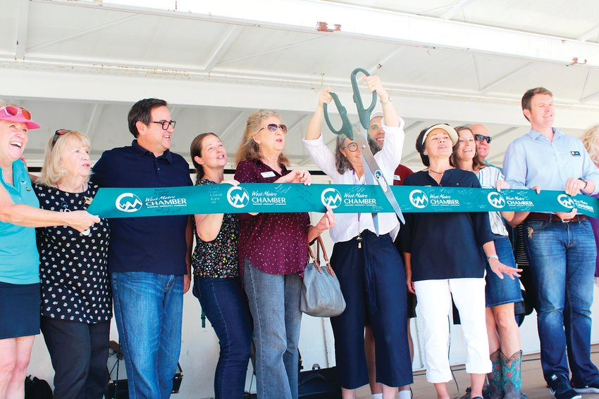 From left, West Metro Chamber President Pam Bales, Red Rocks Community College President Michele Haney, Lakewood Mayor Adam Paul, Jeffco Public Schools board member Amanda Stevens, Edgewater Mayor Laura Keegan, Action Center Executive Director Pam Brier, Action Center Board President Cindy Baroway and Colin Larson, a Republican candidate for HD22. The group cut a ribbon celebrating the next 50 years of the Action Center.