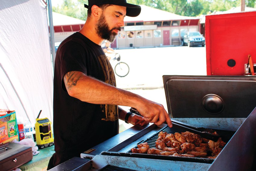 Mohamed Hadidi, owner of Lord of the Wings, cooks up some wings for the Action Center's block party. Other vendors included Kona Ice.
