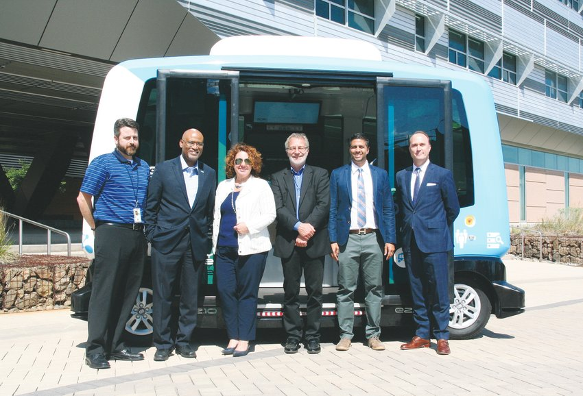 Representatives from National Renewable Energy Laboratory (NREL), EasyMile and MV Transportation stand in front of the EZ10, an autonomous shuttle that made its NREL debut on Sept. 9.
