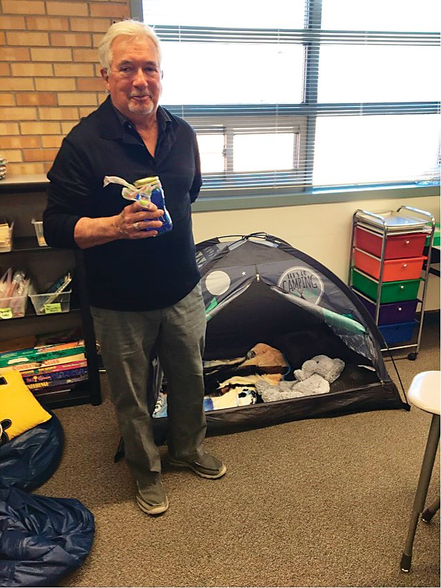 Tom Hughes, chair of the Rotary Club of Golden's mental wellness workgroup, stands next to a Cool Down Corner at Welchester Elementary in Golden. Starting the project at Welchester during the 2017-18 school year, Golden Rotary is providing materials and training for teachers in Golden to install Cool Down Corners in their classrooms.