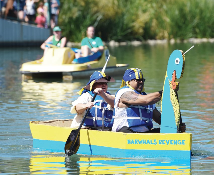 "Victor Holt of Westminster, and Rachel Garcia of Denver a.k.a. ""Captain Fae,"" navigate their entry, ""Narwahl's Revenge"" in the Cardboard Regatta event of this year's Northglenn Pirate Fest, at E. B. Rains, Jr. Memorial Park Sept. 15."