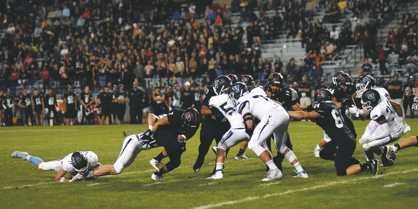 Pomona junior AJ Zamora (7) doesn't find much running room against Valor's defense Friday, Sept. 13, at the North Area Athletic Complex. The Panthers were edged by the defending Class 5A state champions 17-13 in the top-10 match-up.