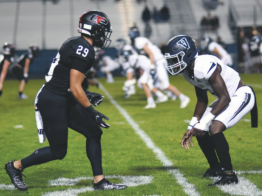Pomona senior Chase Lopez (29) goes head-to-head against Valor junior Zaire Jackson during the first half Friday, Sept. 13, at the North Area Athletic Complex. Lopez caught a touchdown pass against is former team, but the Panthers suffered a 17-13 loss.