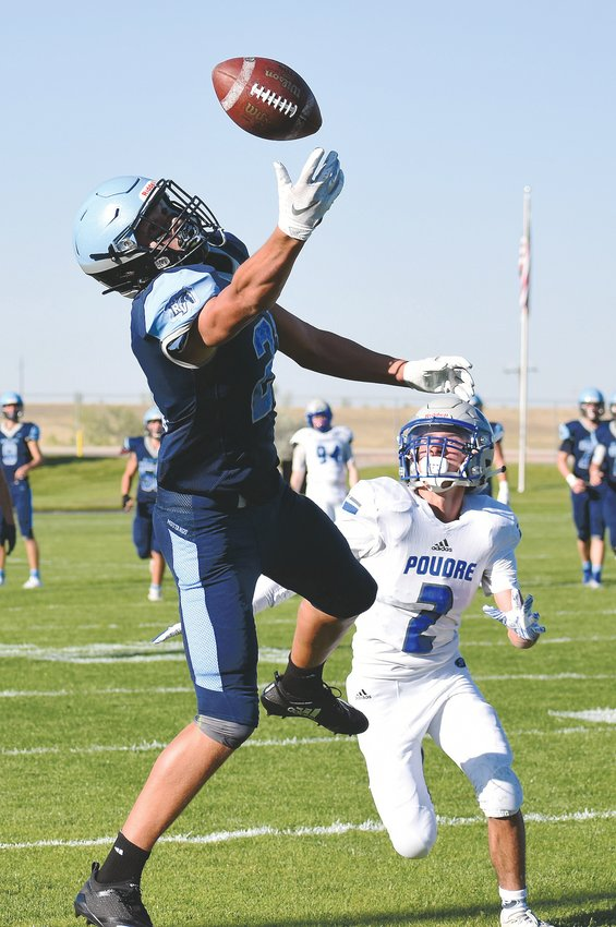 Ralston Valley senior Caleb Rillos, left, reaches for a pass near the end zone late in the first half Friday, Sept. 13, at the North Area Athletic Complex. Rillos, who is coming back from a broken wrist he suffered last winter during basketball season, already has five touchdown catches during the Mustangs' 3-0 start.