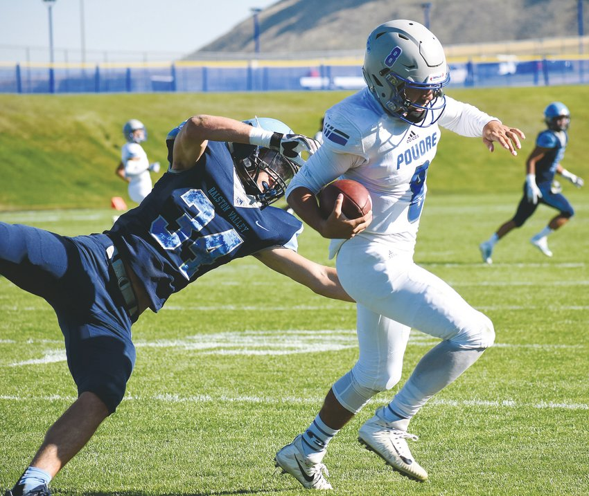 Ralston Valley senior Braden Siders (34) shoves Poudre quarterback Sergio Tarango out of bounds during the Mustangs' 40-7 victory Friday, Sept. 13, at the North Area Athletic Complex.