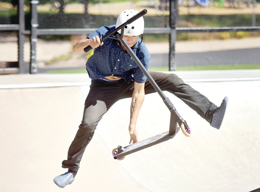 Aaron McCann competes during the annual Ruler of the Railzz competition at Redstone Skate Park on Saturday, Sept. 14. McCann placed first in the Advanced Street Scooter category.