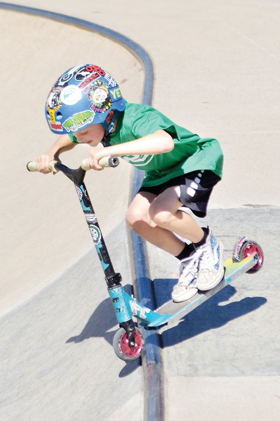 Bubba Navarre, 6, drops in to the mini bowl at Redstone Skate Park during the annual Ruler of the Railzz competition. Navarre was one of the youngest competitors and received a large round of applause after his run.