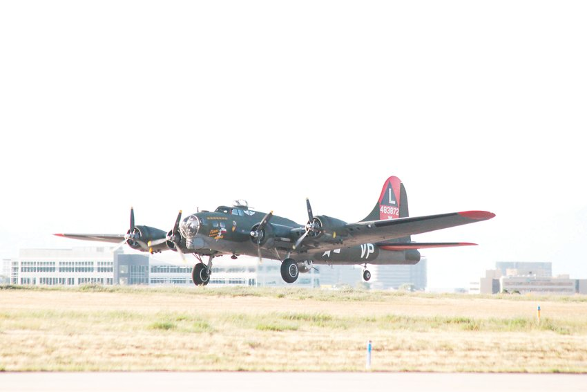 The Commemorative Air Force's B-17, dubbed Texas Raiders, slips the surly bonds of Earth at Centennial Airport. The plane's visit was an emotional experience for spectators.